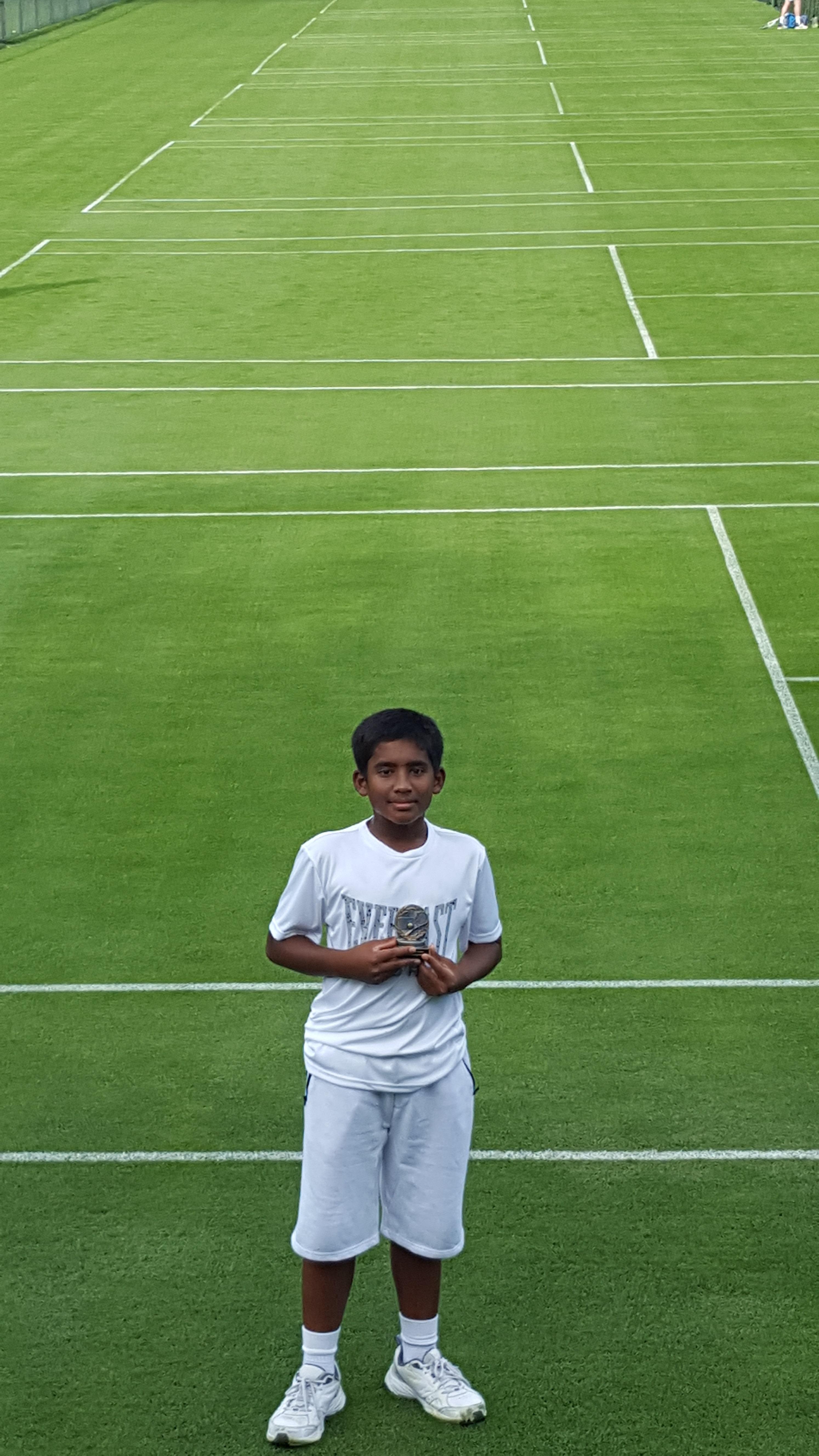 Naveen grasscourt